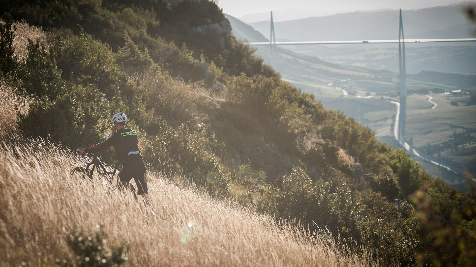 VTT enduro on the causse of Larzac in front of the viaduct of Millau